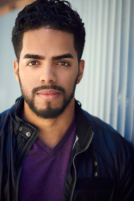 Male latino actor in natural light headshot with relaxed expression