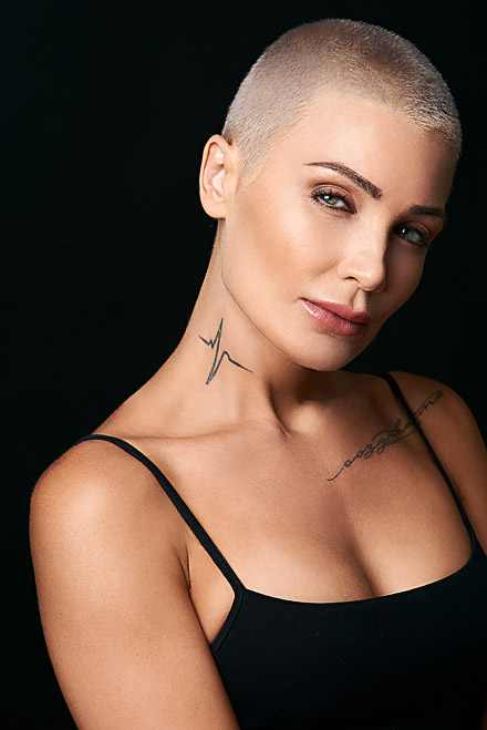 Theatrical headshot of beautiful actress with tattoos